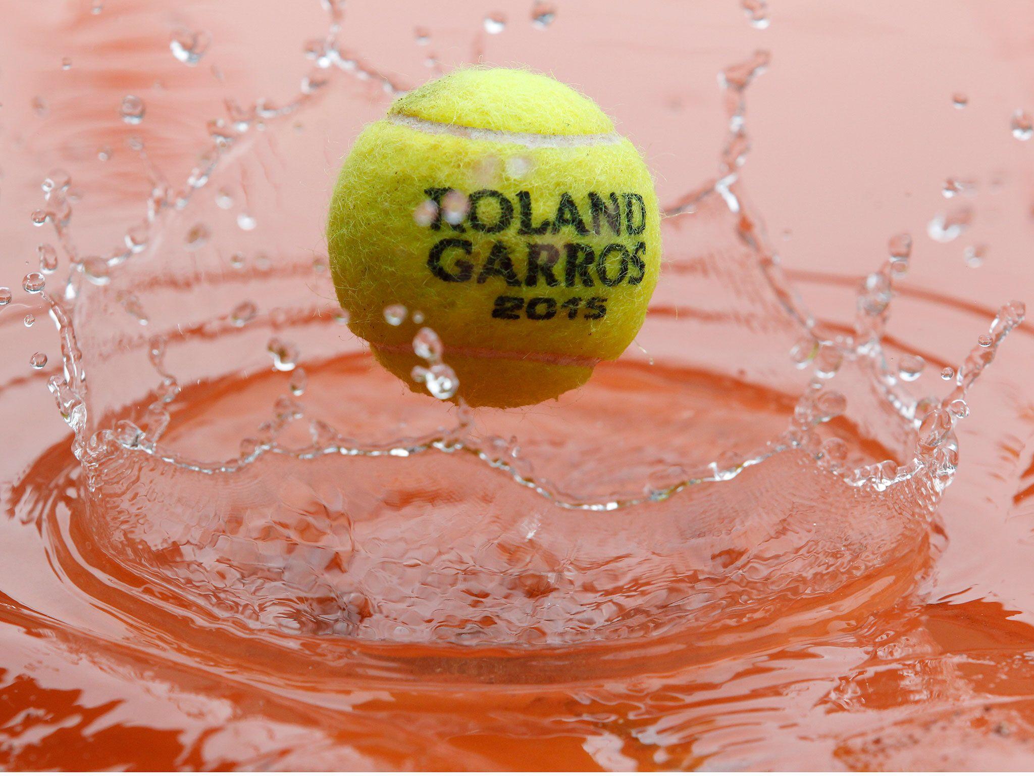 The tennis balls have some fun splashing around in the