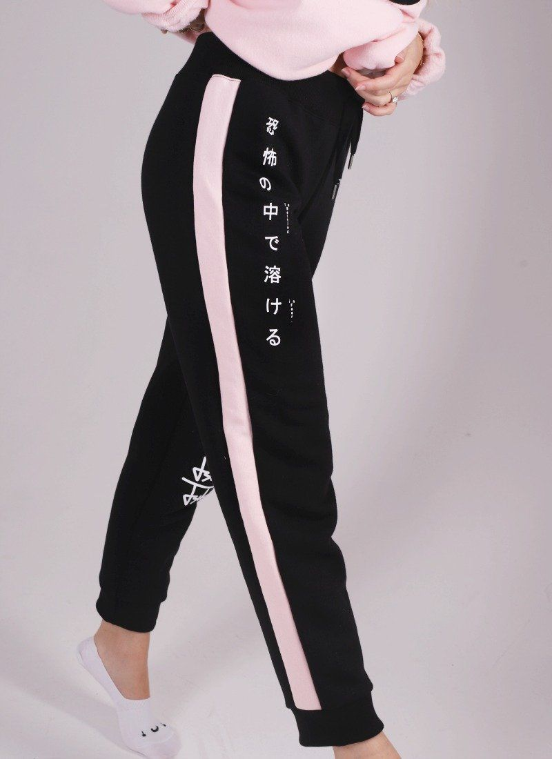 a10706153 Slim fit black fleece joggers with pink side seam insert. Marzia is wearing  an Extra