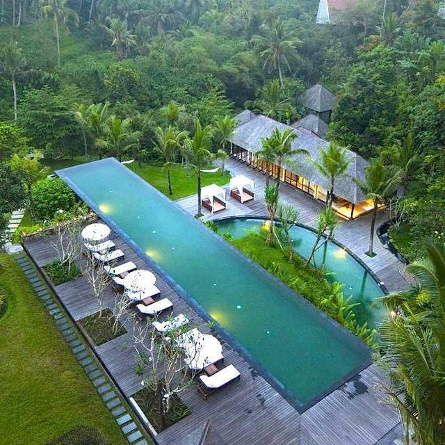 An infinity edge swimming pool located at the alila ubud for Ubud boutique accommodation