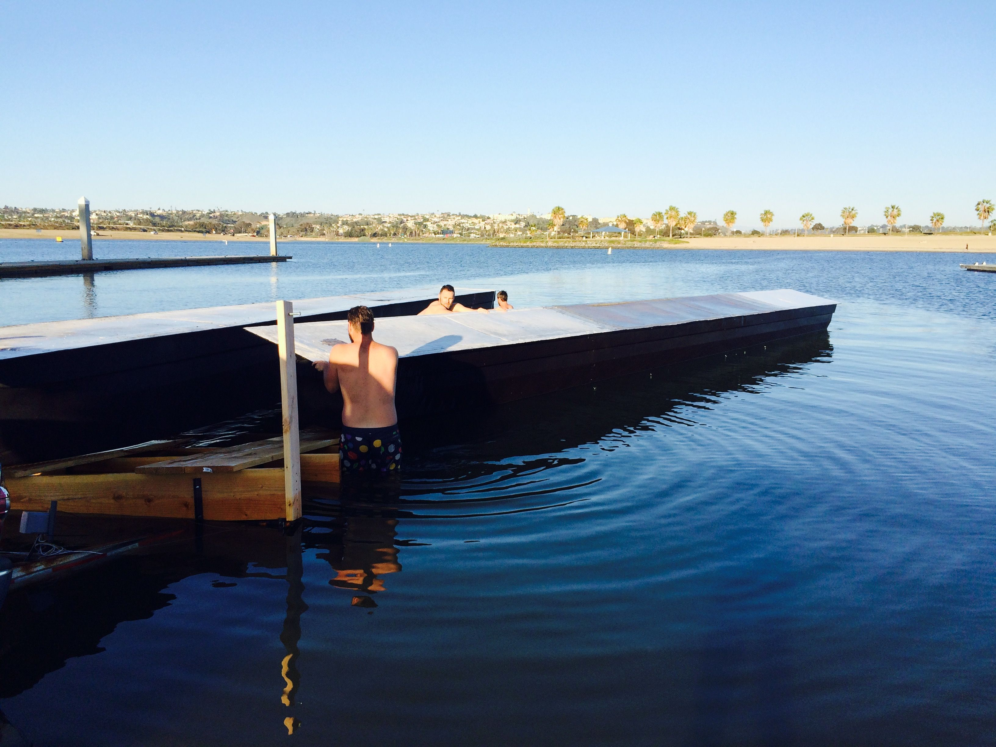 Flipping The Pontoons Right Side Up When Machinery Can T Do The Job Www Sandiegopontoon Com San Diego Pontoon Boat Rental Pontoon Boat Boat Rental Pontoon