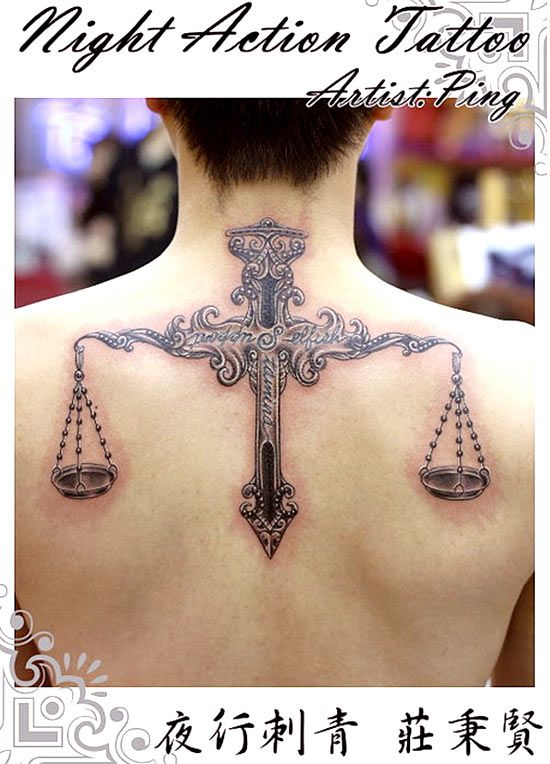 Libra tattoo on a man's back | Show me a man with a tattoo and I'll show you a man with an ...