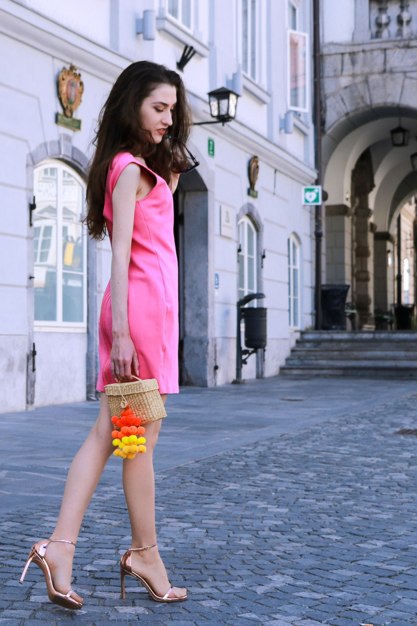9c9f1e4eb320 Fashion blogger Veronika Lipar of Brunette From Wall Street sharing how to wear  pink cocktail dress