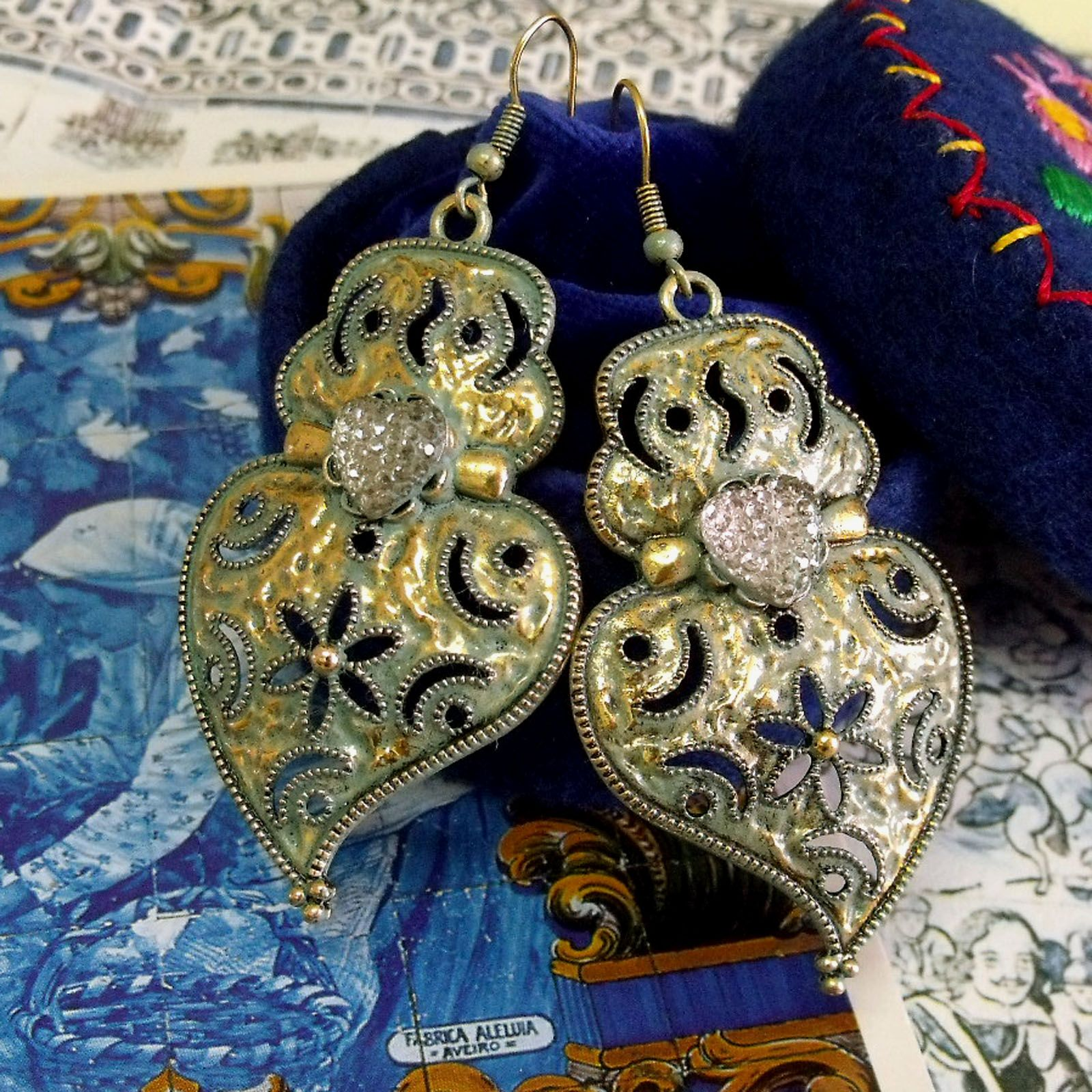 Portuguese folk jewelry Hearts of Viana gold tone earrings with verdigris and frosted heart. It is my modern aged version of the traditional style lacy hearts dangle earrings.$39.00...#portuguesefolkjewelry#portugalvianahearts#portuguesefolkart#madeinPortugal#bigheartearrings#verdigrisjewelry