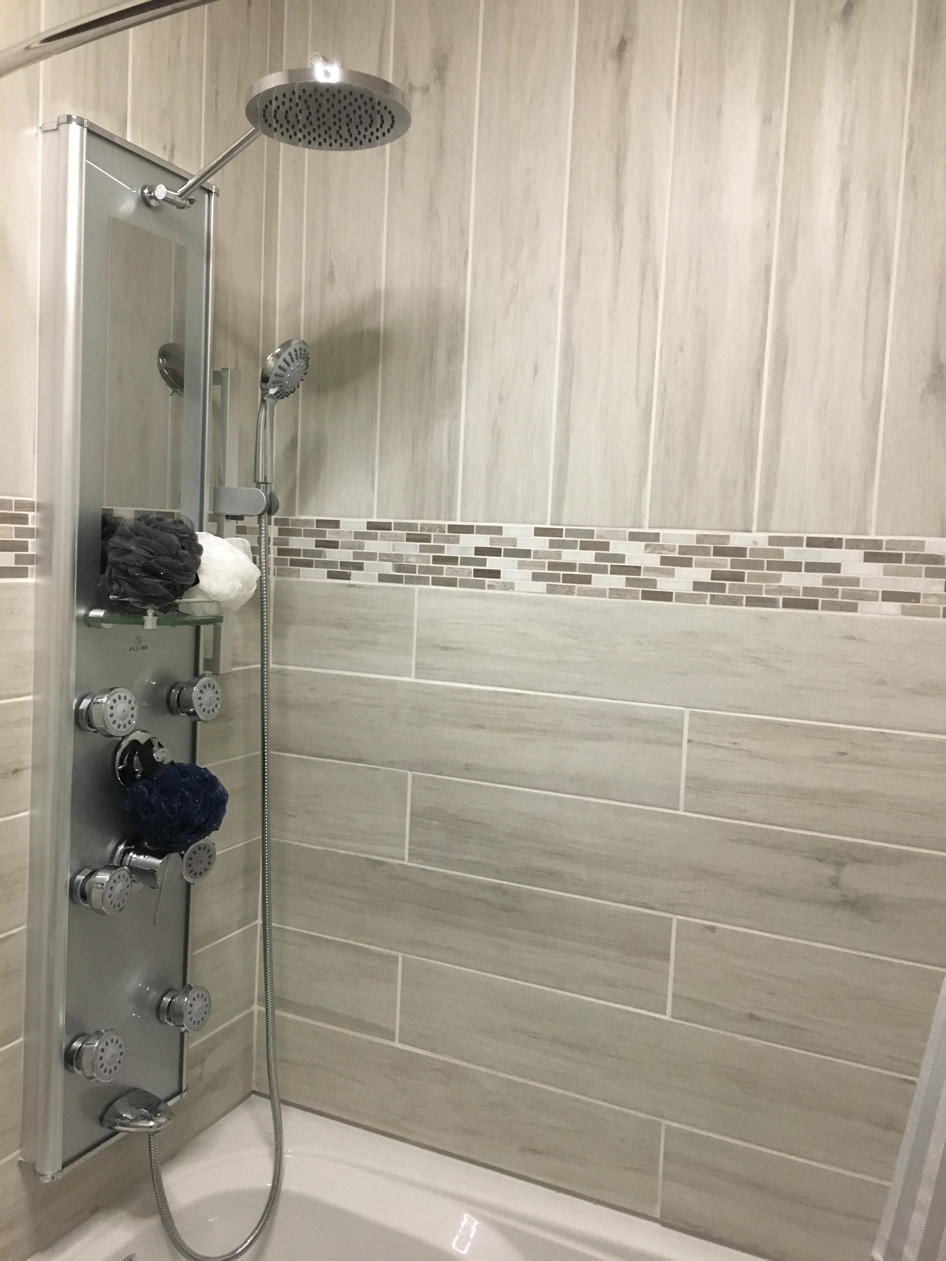 Beach Wood Look Porcelain Tile With Mosaic Accent Band Shower Tub Combo Panel Jets