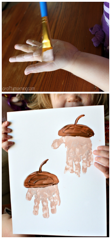 Handprint Acorn Art Project #Fall craft for kids - This was our attempt which still turned out cute even though she wouldn't put her fingers together!