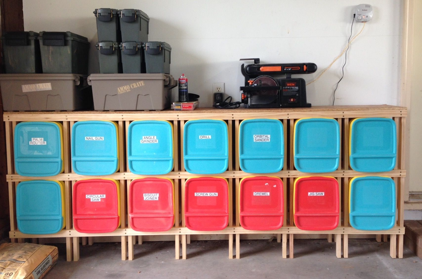 Old cat litter containers recycled for storage in our garage Made
