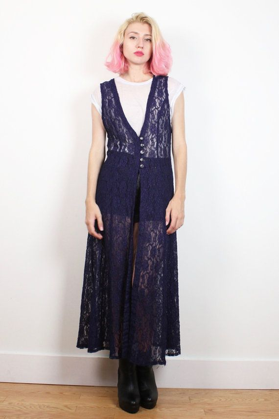 Vintage vest. Sheer, navy lace. Unlined. Button shirt front. Tie waist back. Front and side slits. A unique layering piece. Shoulder Width:  Bust: 38 Waist: 34 untied Hips:  Length: 49 Tag: Jessica Howard. 16. 100% polyester Fits Like: L/XL  Accessories are not included unless listed in the item description For reference the model is 57, and a US size 2.     **PAYMENT/ SHIPPING/ REFUNDS/ SIZING: Please review my shop policies before buying. Thank you…