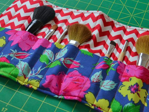 Make up brush roll.... and a crochet hook roll... I see BOTH of them ...