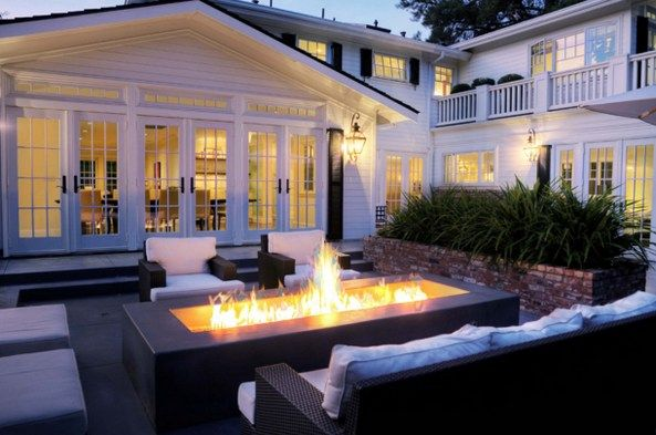 Delicious backyard patio with long openair gas firepit