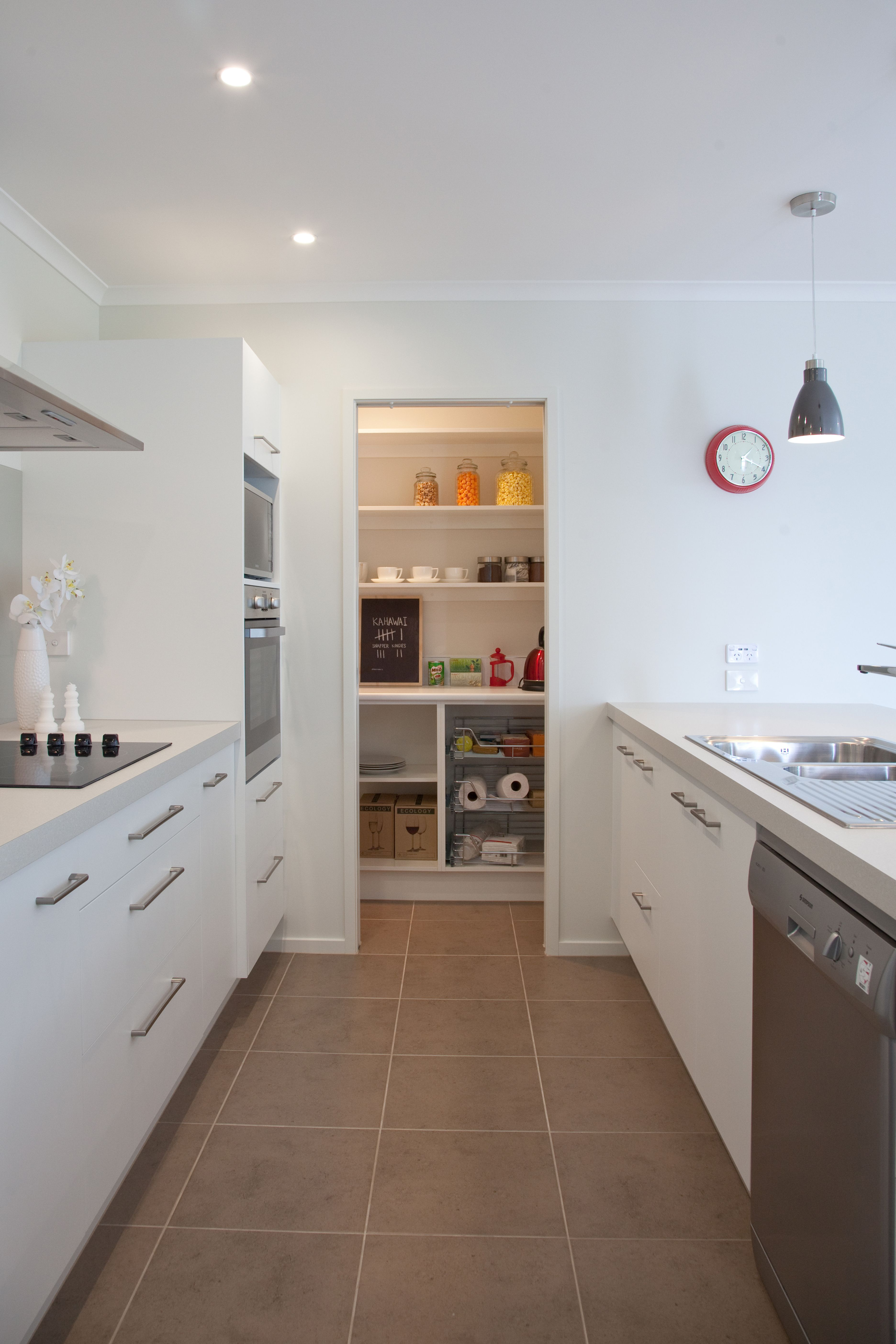 Kitchen with a nice big scullery at the end to hide any mess ...