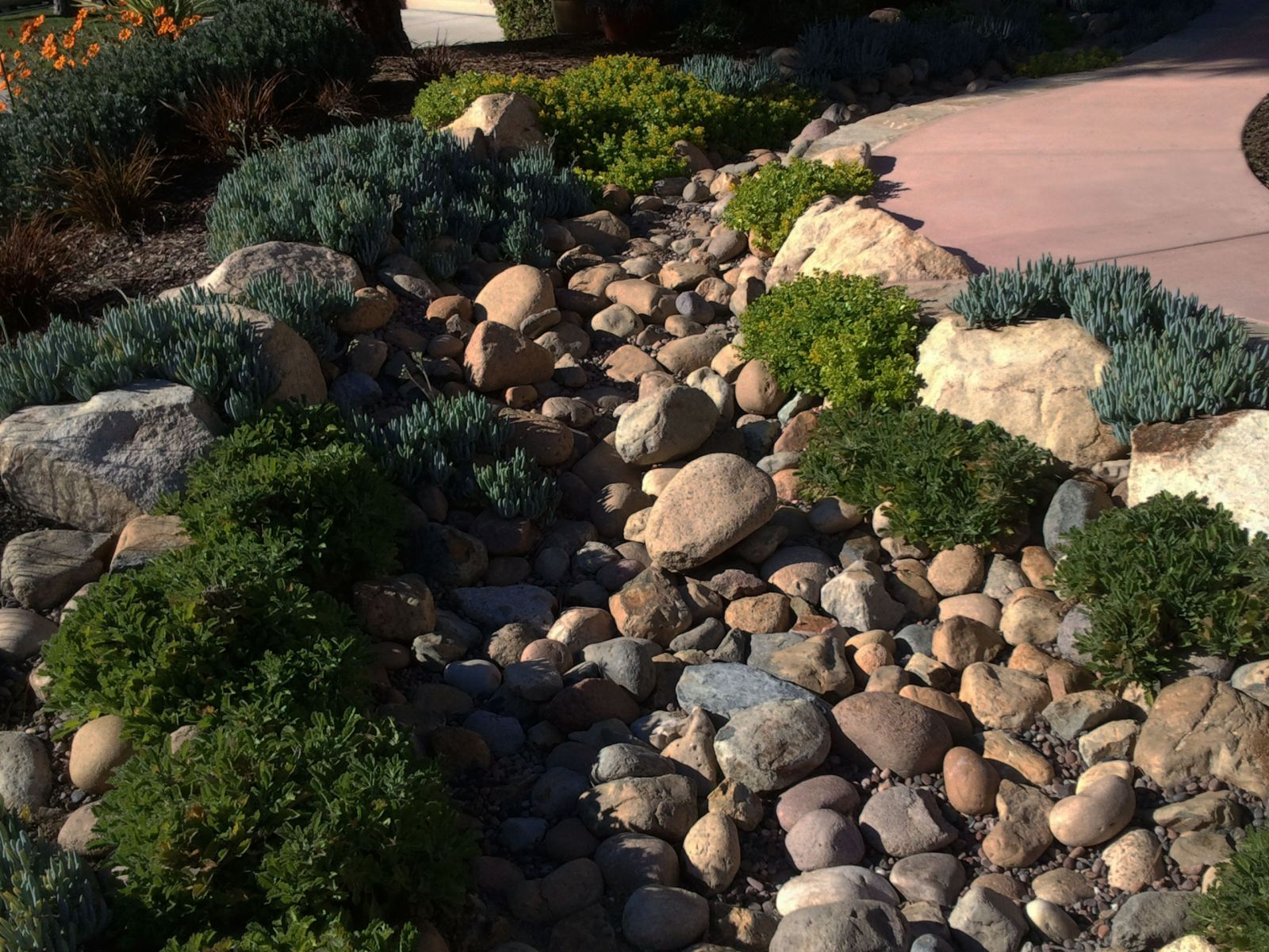 Mulch landscape rock wood by richard rock on pinterest for River rock landscaping