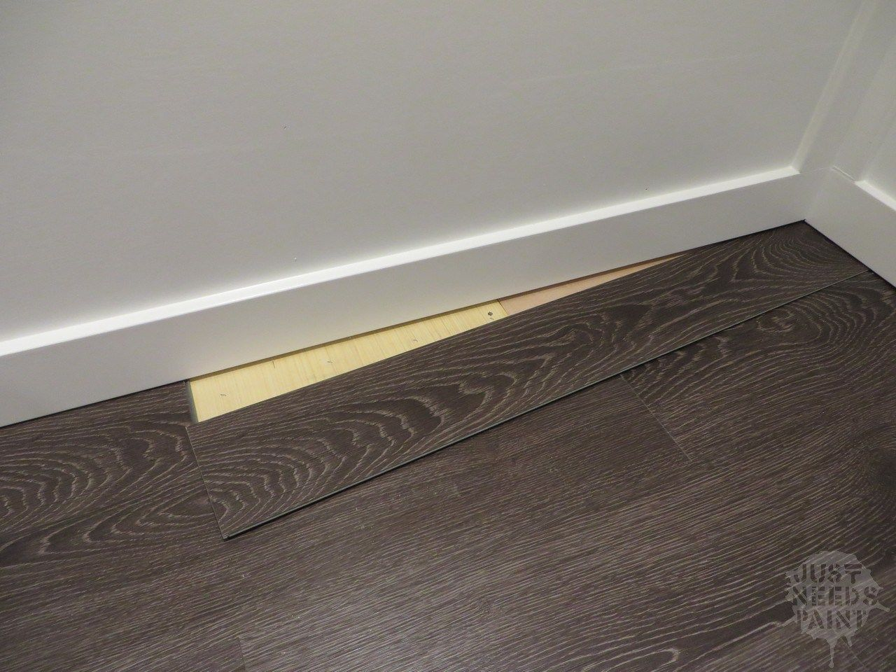 How To Install Click Laminate Flooring Without Removing Baseboards Just Needs Paint Click Laminate Flooring Removing Baseboards Installing Laminate Flooring