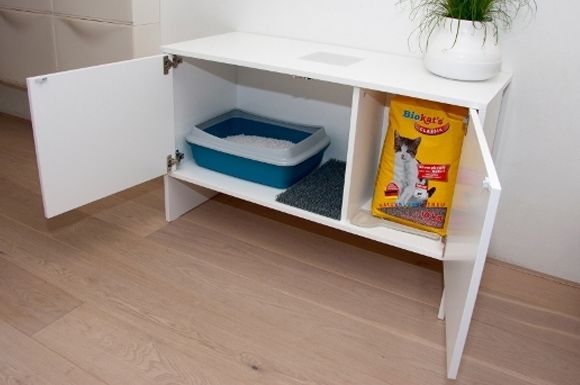 Enclosed and concealed cat litter box with storage for cat food.  Brilliant idea to hide the cat box!
