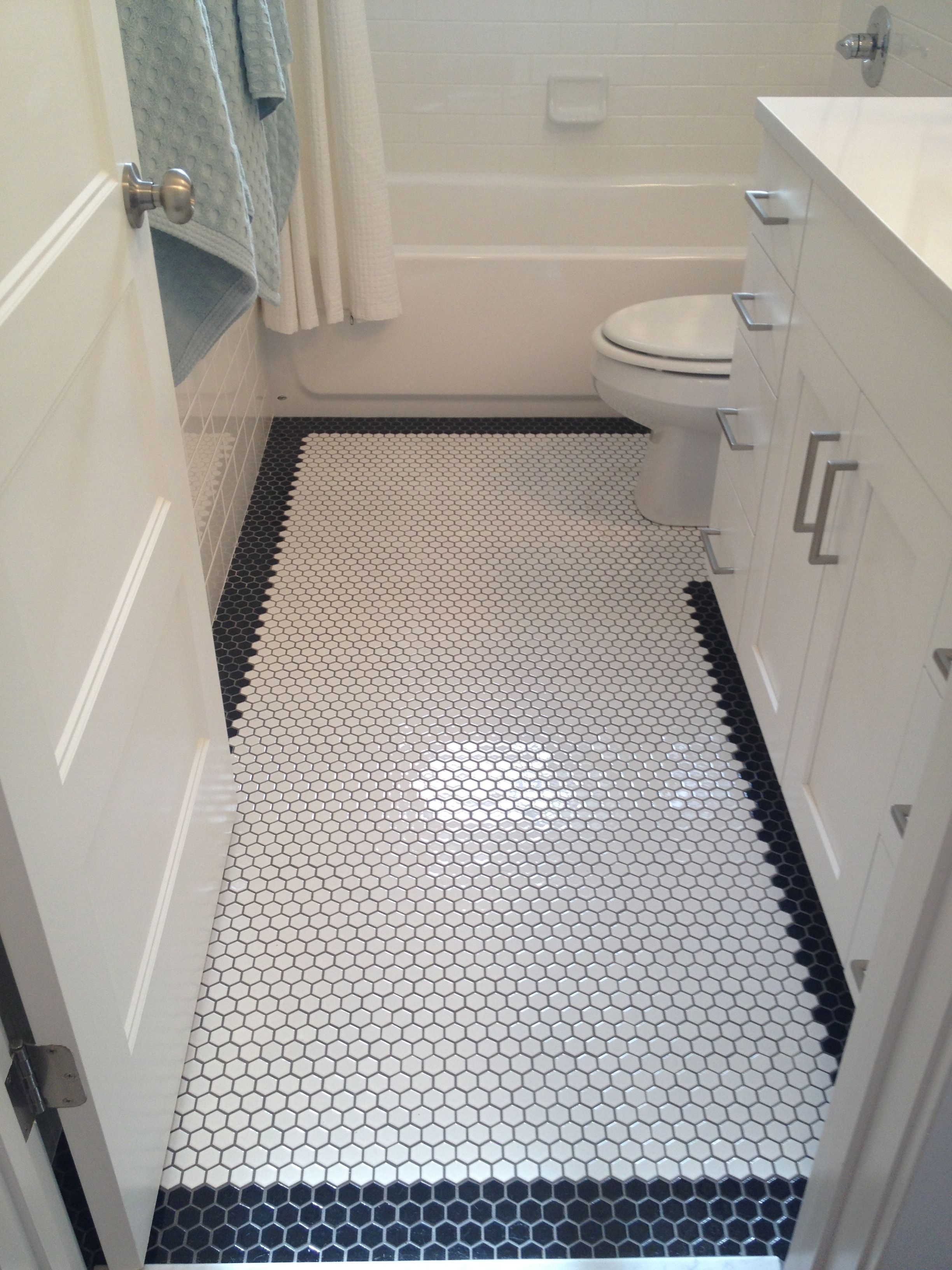 White octagon floor tile with black octagon border