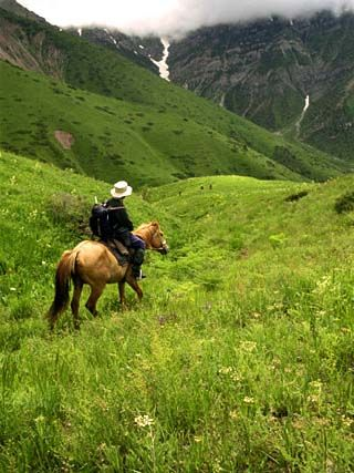 Tourist on Horseback in the Aksu Dzhabagly Reserve Tien Shan
