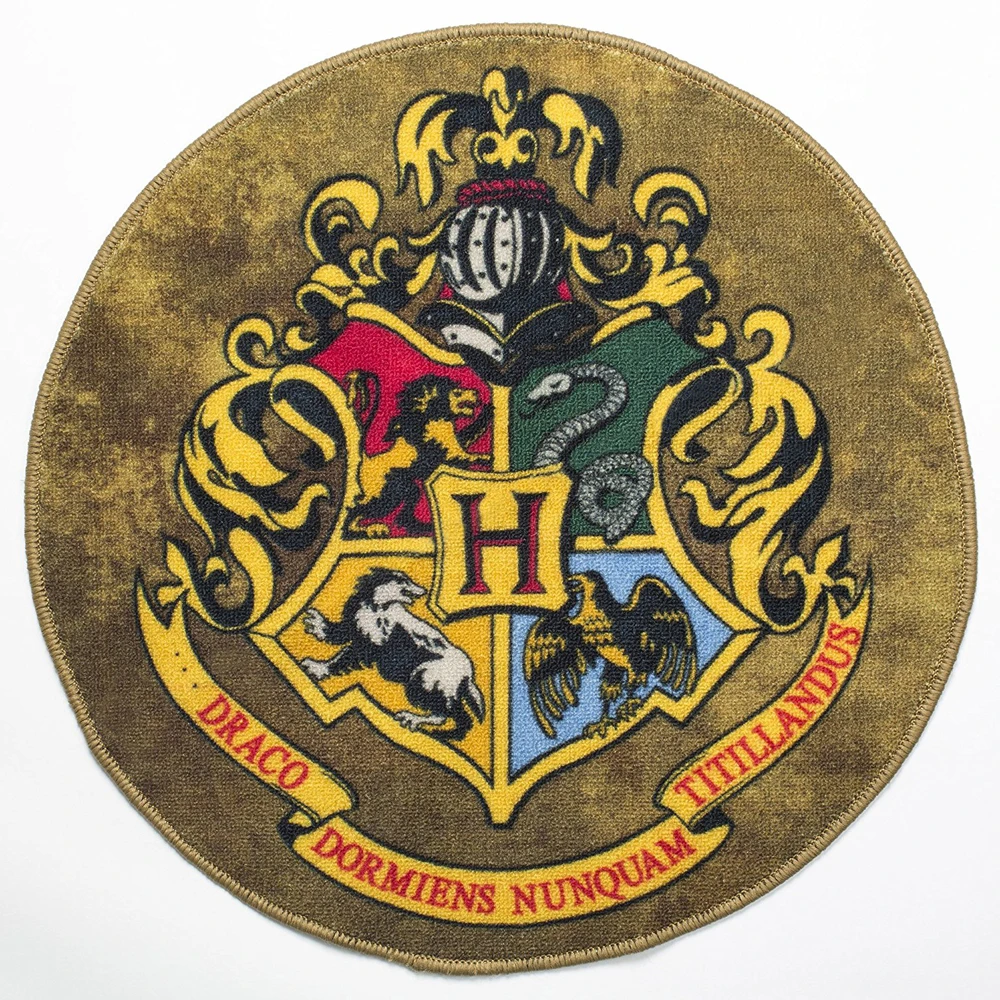 The Richly Colored Doormat Features The Coat Of Arms From Harry Potter The Escutcheon Displays The Masc Harry Potter Shop Hogwarts Crest Harry Potter Pictures
