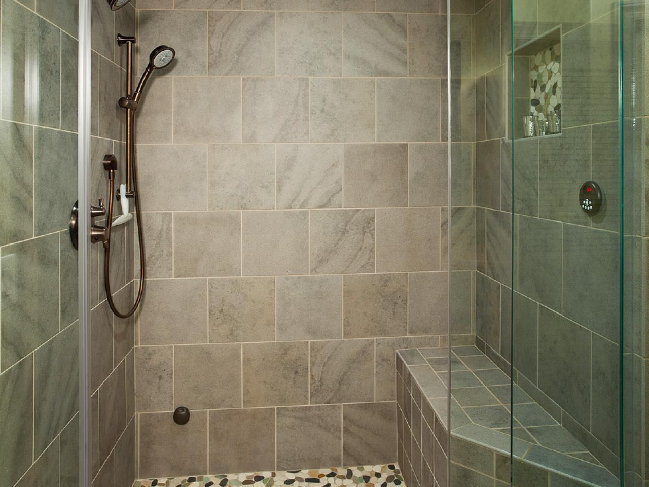 This Contemporary Shower Comes Complete With An Aromatherapy Steam System Gray Tile And A River Rock Floor Evoke Natural Elements Create Sense Of