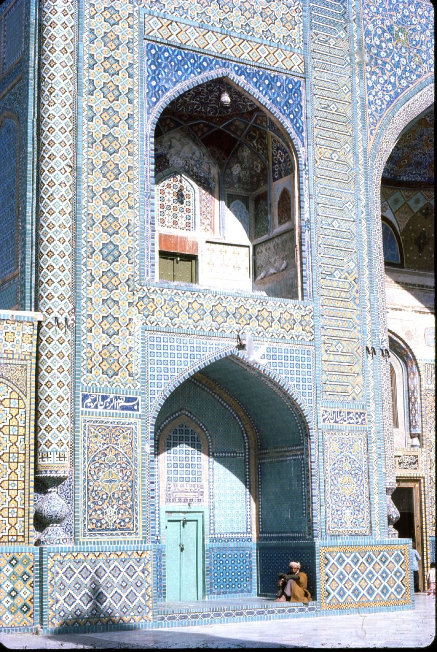 An Afghan man takes refuge in an alcove of the Hazrat Ali Shrine, known fondly as the Blue Mosque. Mazar-I-Sharif, Balkh Province.