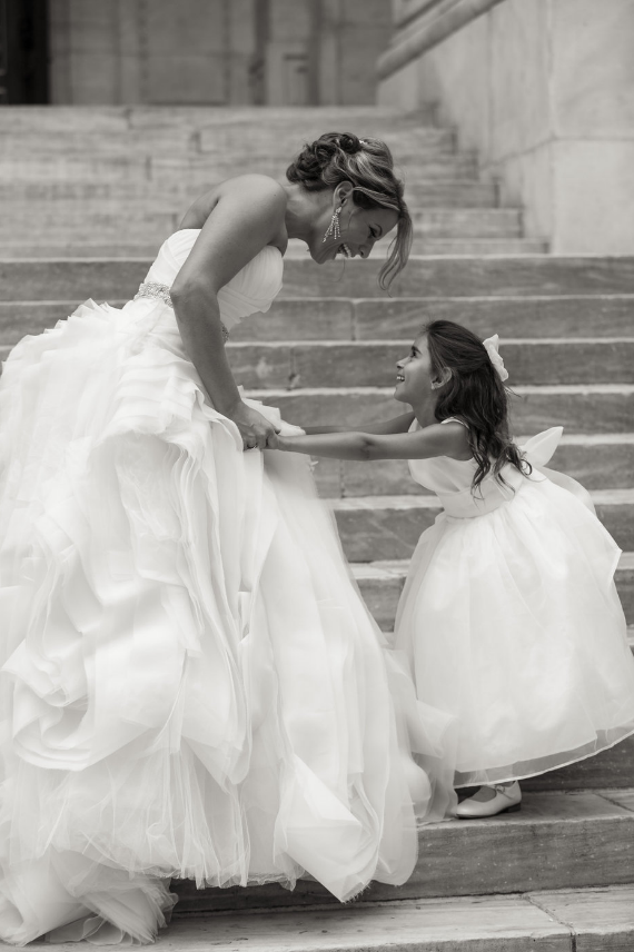 Everyone needs a shot like this! Bride and flower girl. This is wonderful and so happy.