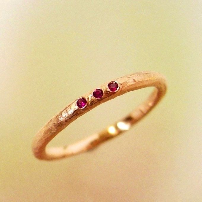 Rose Gold Ruby Wedding Band, Stacking Ring, Wedding Ring, Engagement Ring, Thin Band, Three Stone Ring, Womens Wedding Ring, Made to order by PatrickIrlaJewelry on Etsy https://www.etsy.com/listing/53308553/rose-gold-ruby-wedding-band-stacking