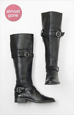 Tall, black boots. Some leather, some buckles, maybe these, maybe not.