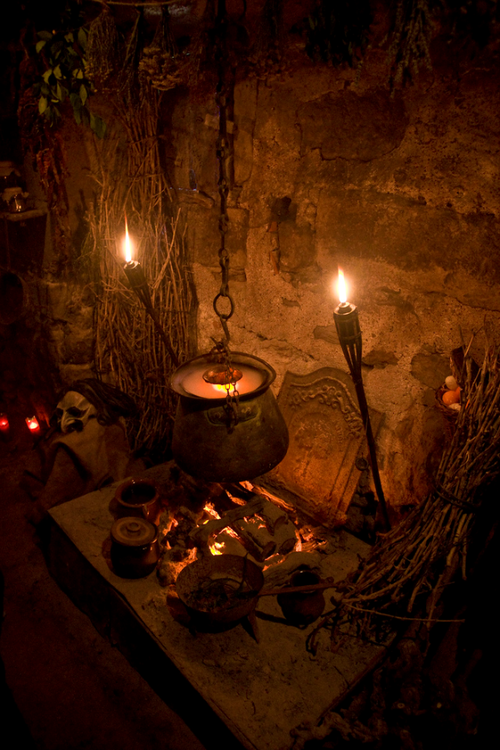 Halloween witch scene cauldron. love the [tiki] torches