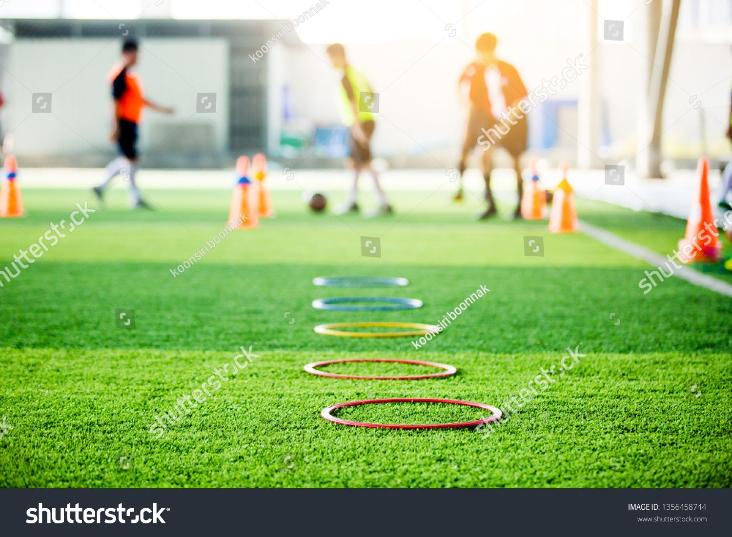 Selective Focus To Ring Ladder Marker And Cone Are Soccer Training Equipment On Green Artificial T Soccer Training Equipment Soccer Training Training Equipment
