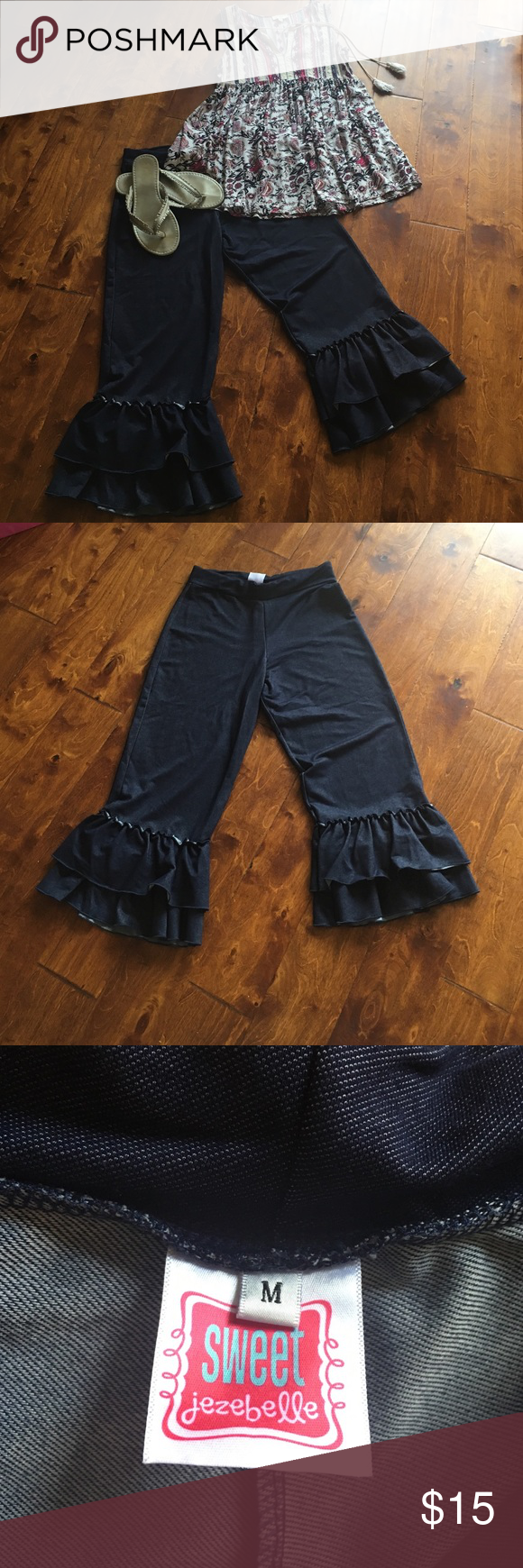 """Ruffle Capris Dark """"denim like"""" ruffle capris. Elastic waist size medium but fits like a small. Very very cute! Perfect with wedges or flats! boutique  Pants Capris"""