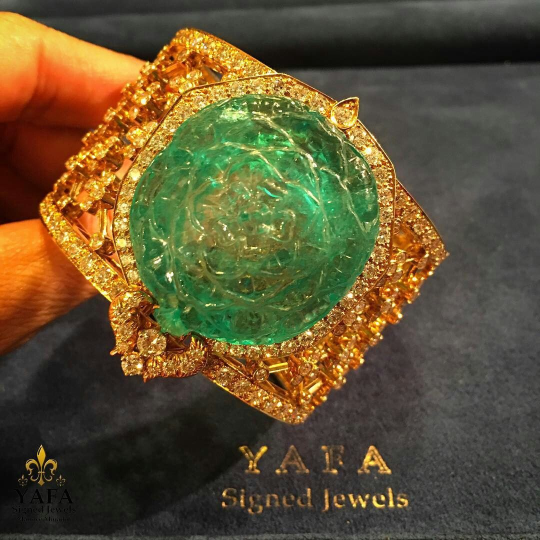 By vancleef a magnificent cuff bracelet with an emerald carved