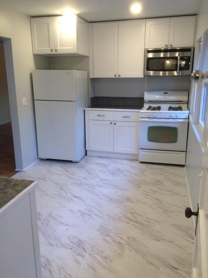 Trafficmaster 12 In X 24 In Peel And Stick Carrara Marble Vinyl Tile 20 Sq Ft Case Ss1212 At The Home Depo Vinyl Tile Peel And Stick Floor Marble Vinyl