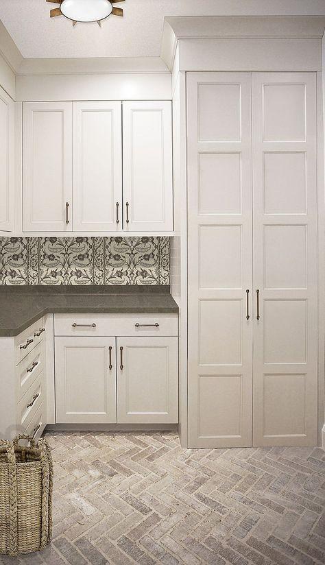 Laundry Room With White Cabinets Black And Backsplash Tile Herringbone Brick Flooring