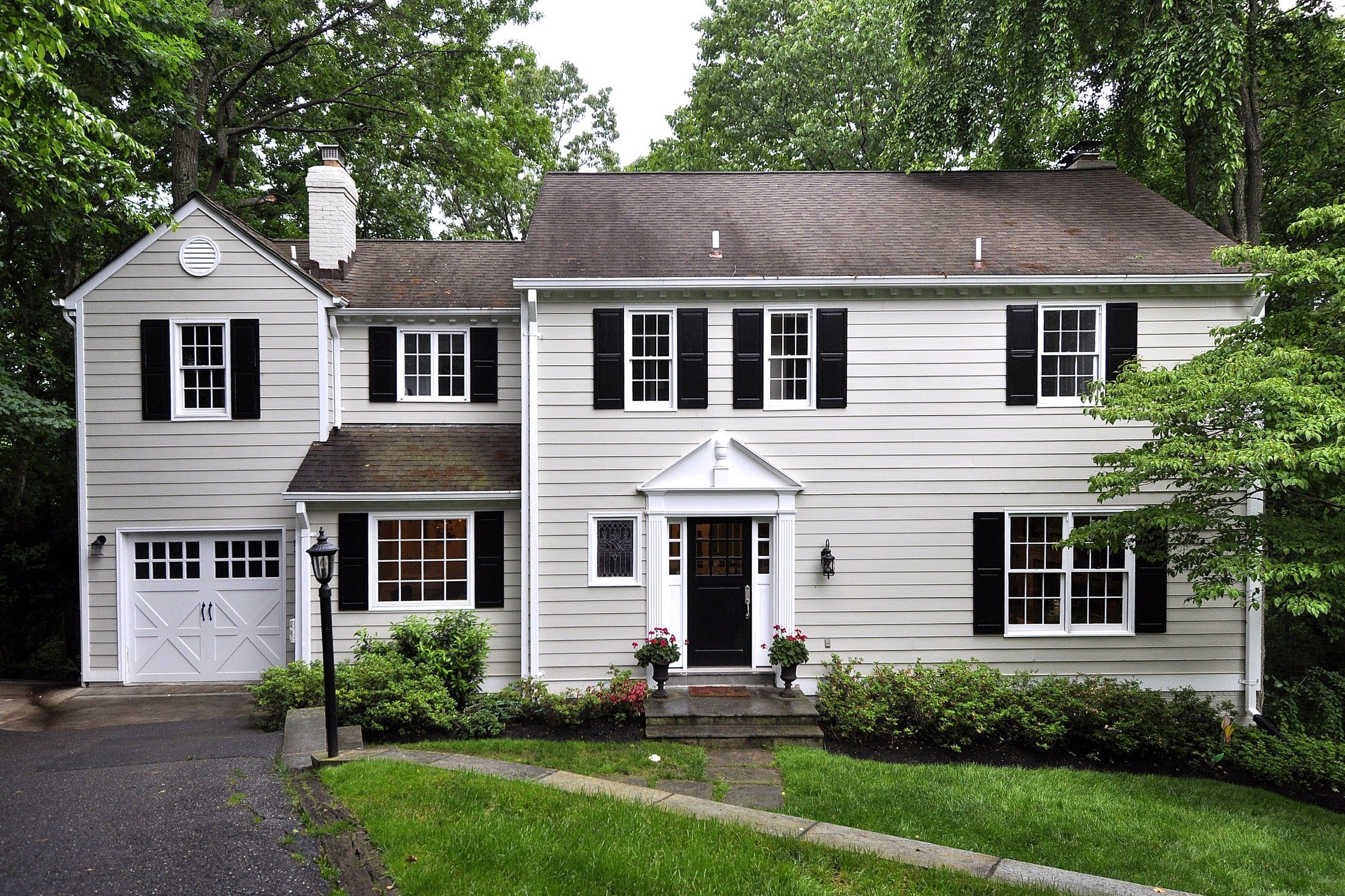 Love This Exterior Paint Color For A Colonial Home White Trim Brown Roof And Dark Shutters Colonial House Exteriors Colonial Exterior White Exterior Houses