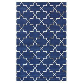 Wool rug in blue rain with a trellis motif. Hand-tufted in India.   Product: RugConstruction Material: 100% WoolColor: Blue rainFeatures:  Made in IndiaHand-tufted  Note: Please be aware that actual colors may vary from those shown on your screen. Accent rugs may also not show the entire pattern that the corresponding area rugs have.Cleaning and Care: These rugs can be spot treated with a mild detergent and water. Professional cleaning is recommended if necessary.