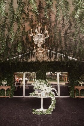 reception tent with hanging greenery all over tented area and tables & reception tent with hanging greenery all over tented area and ...