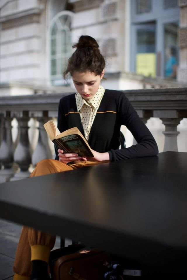 Love it. A woman reading a book.