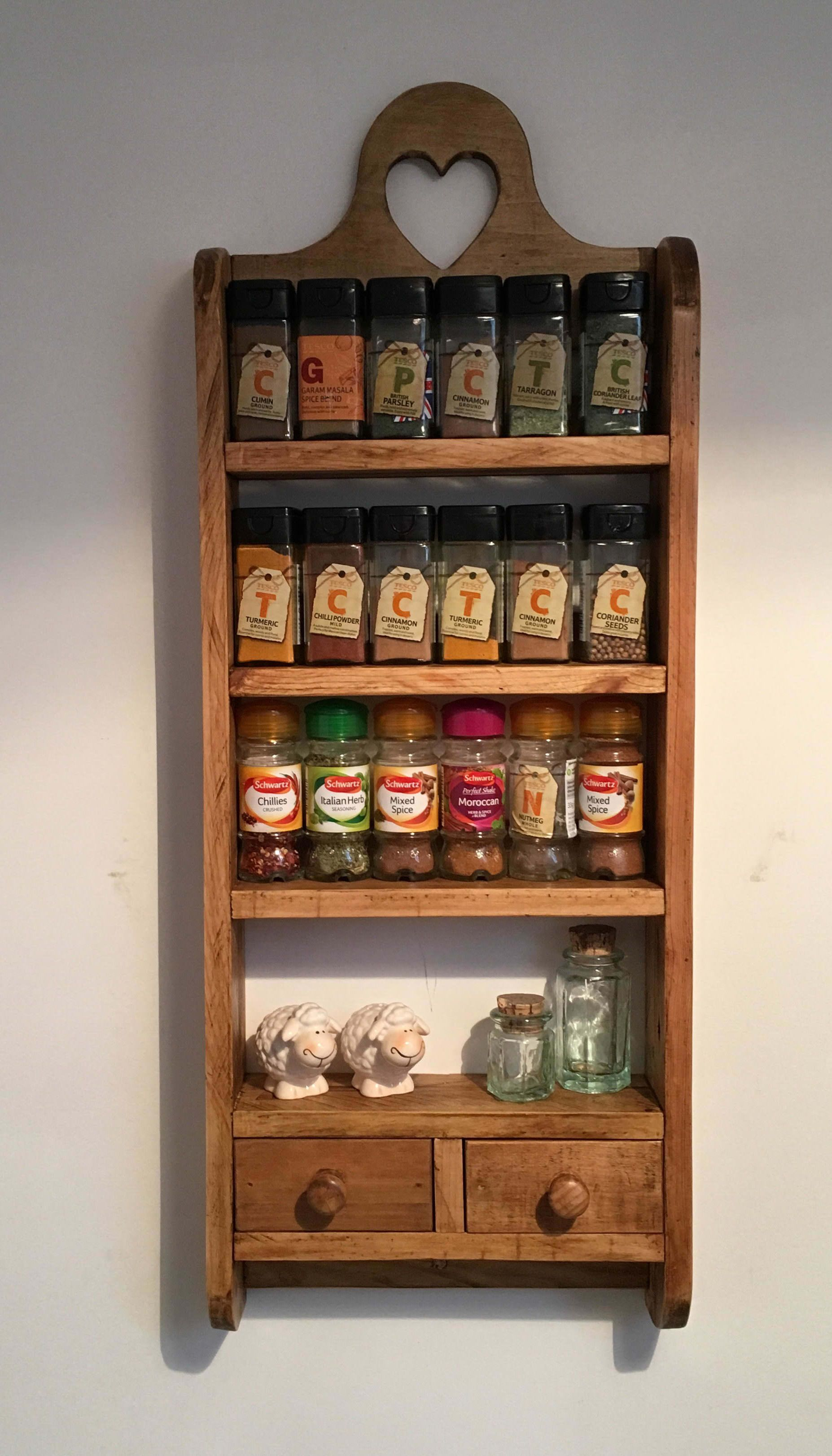 I made this 2 drawer pallet spice rack from a combination of 2 pallets it has curved sides and a decorative heart cutout and sealed with wax