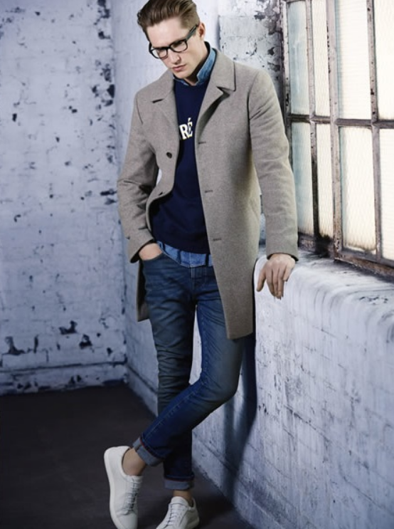 Stylish #topcoat pairs nicely with this causal #jeans & sneakers look. This navy pullover & light blue button down looks impeccable with bright white #kicks.