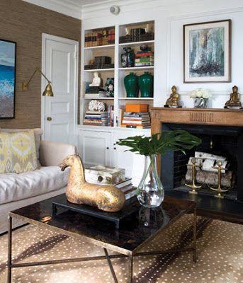 Antelope print rug, built in shelves, fireplace.