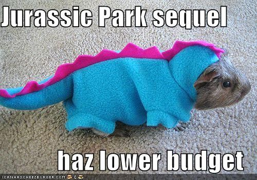 Look at me! Hamster in a dinosaur suit!
