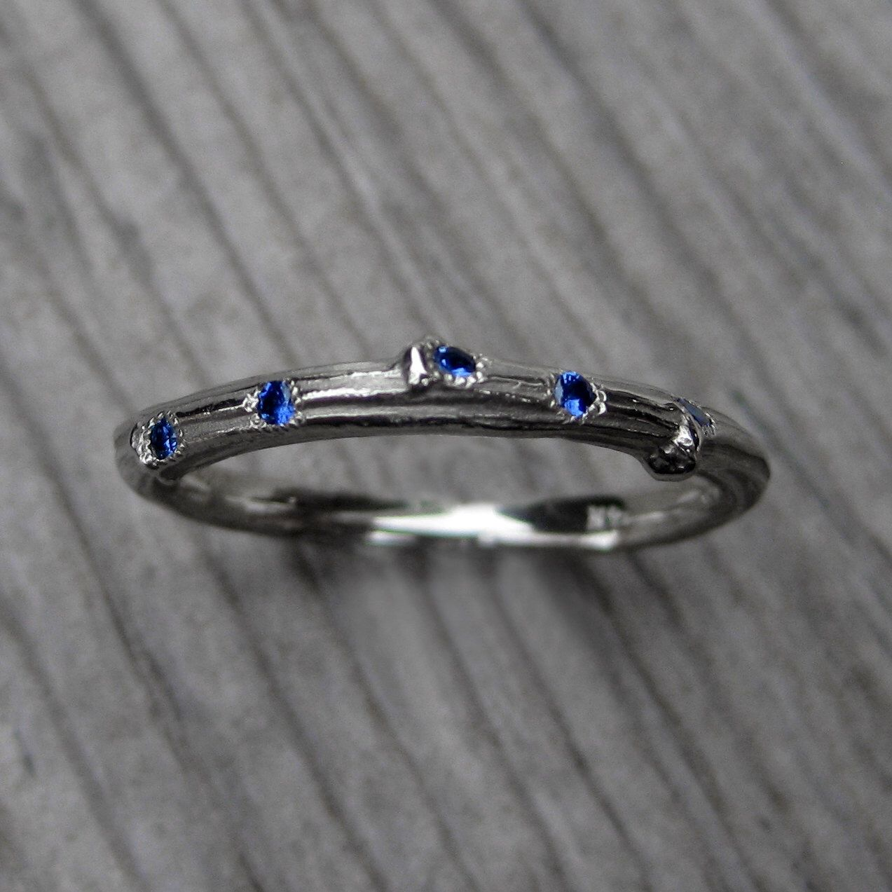 Blue Sapphire Branch Eternity Wedding Band: White, Yellow, or Rose Gold, 11 Sapphires by KristinCoffin on Etsy https://www.etsy.com/listing/181247932/blue-sapphire-branch-eternity-wedding