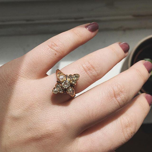 Sparkling mine cut diamonds and delicate black tracery enamel come alive in this Victorian era beauty! abrandtandson.com