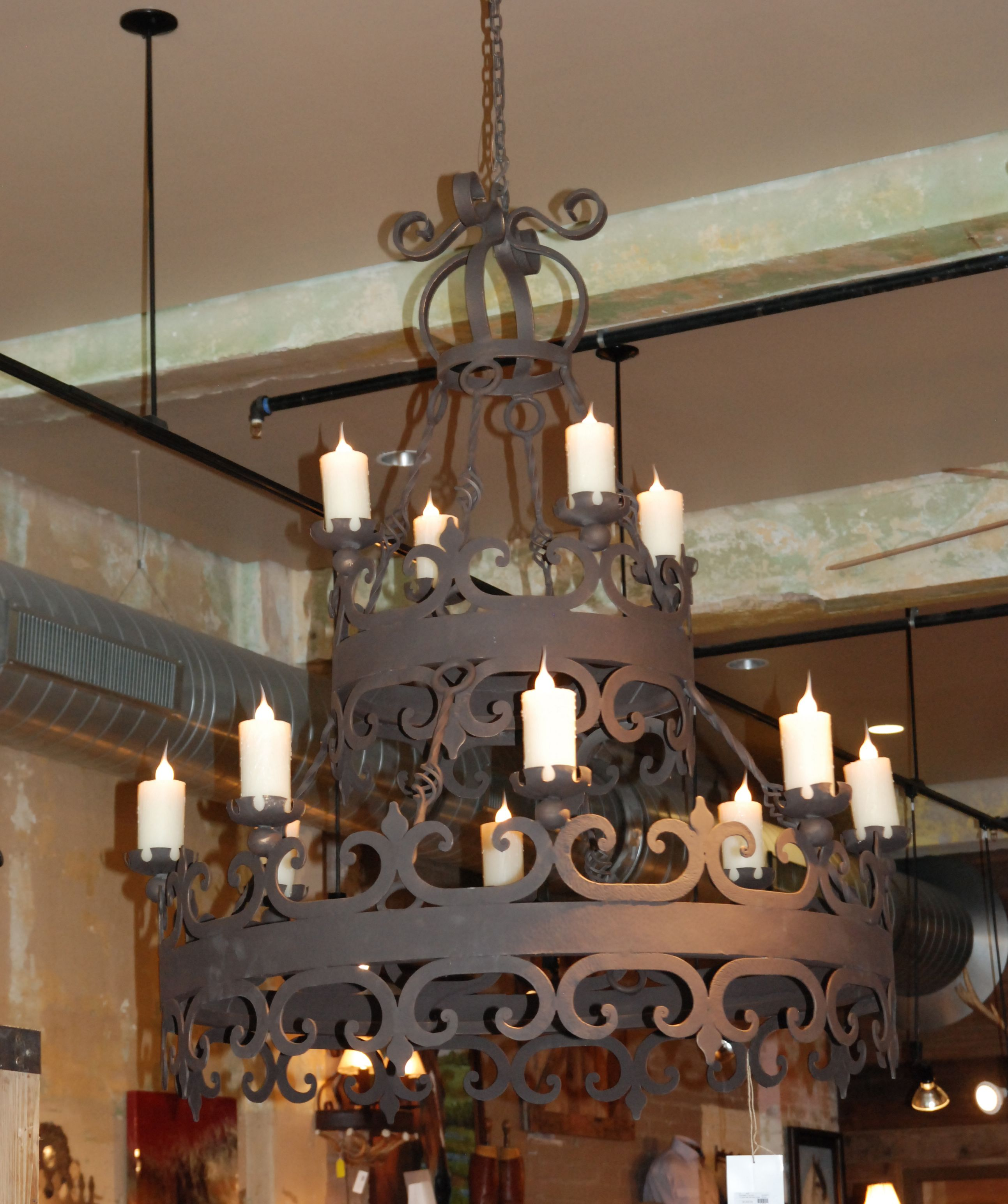 2 Tier Iron Chandelier w 12 lights and wax covers to give the