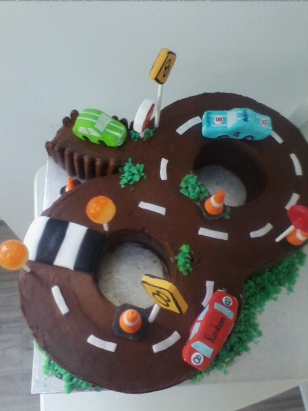 Figure of 8 racing car cake Chocolate flavour with fondant signs
