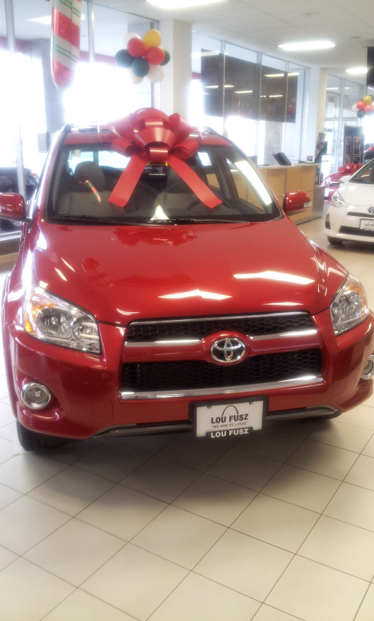 Becuase everyone loves a giant holiday bow when they get a new car taken from