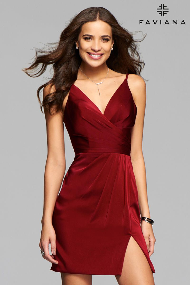 this stunning number is an exquisite satin dress with a deep