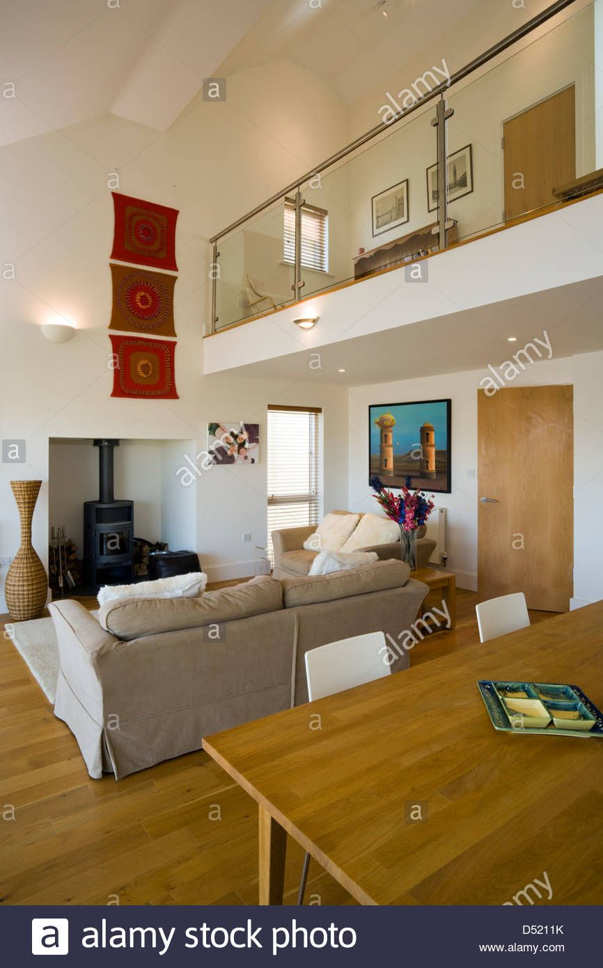 An Open Plan Living Dining Room With A High Ceiling And A Small