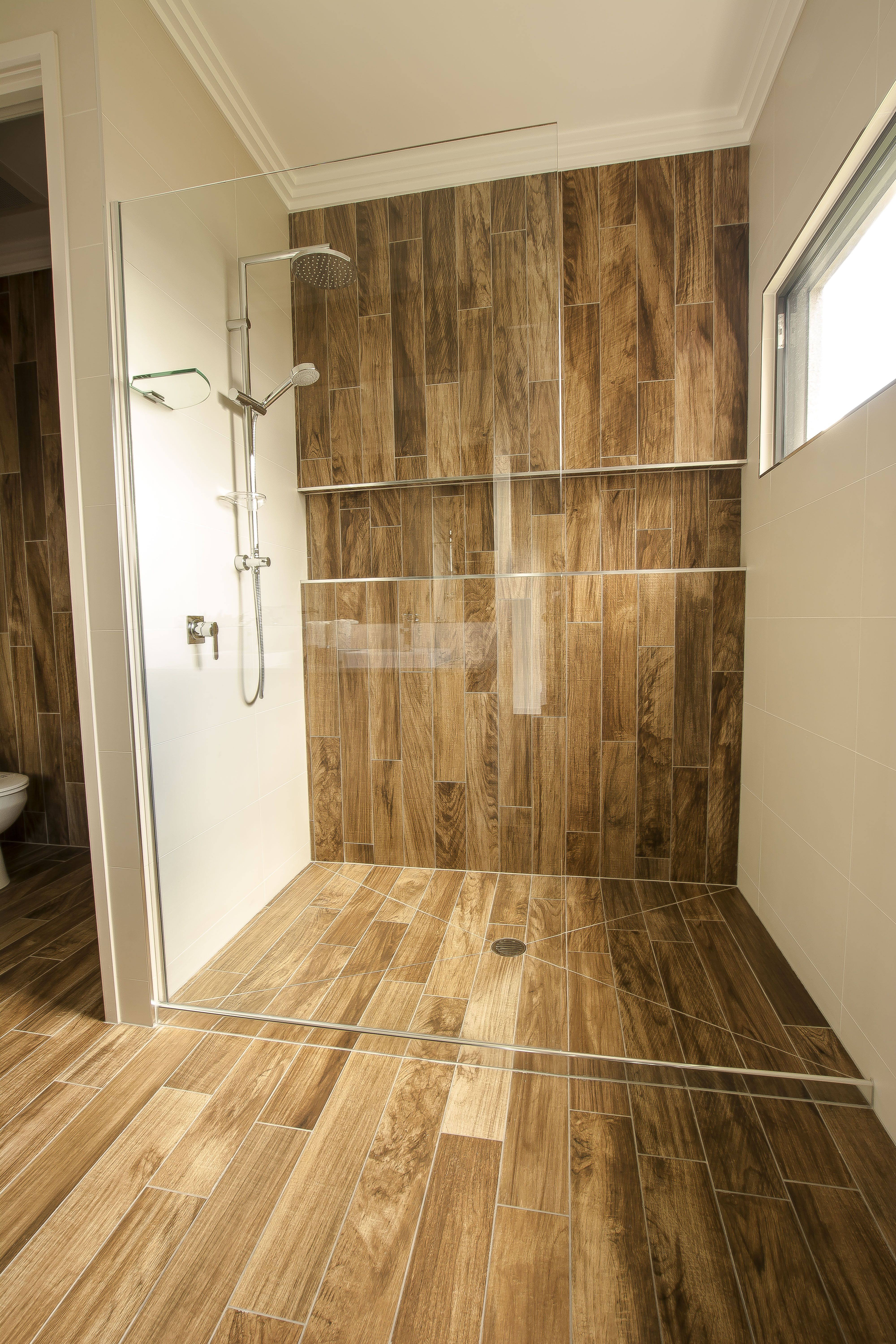 Spacious Ensuite Shower With Wood Look Tiles By Mccarthy Homes Bathroom Design Home Builders Home