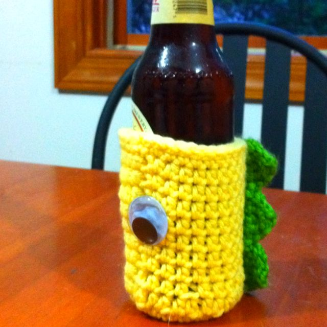 Crocheted dinosaur bottle coozy made for a charity auction.