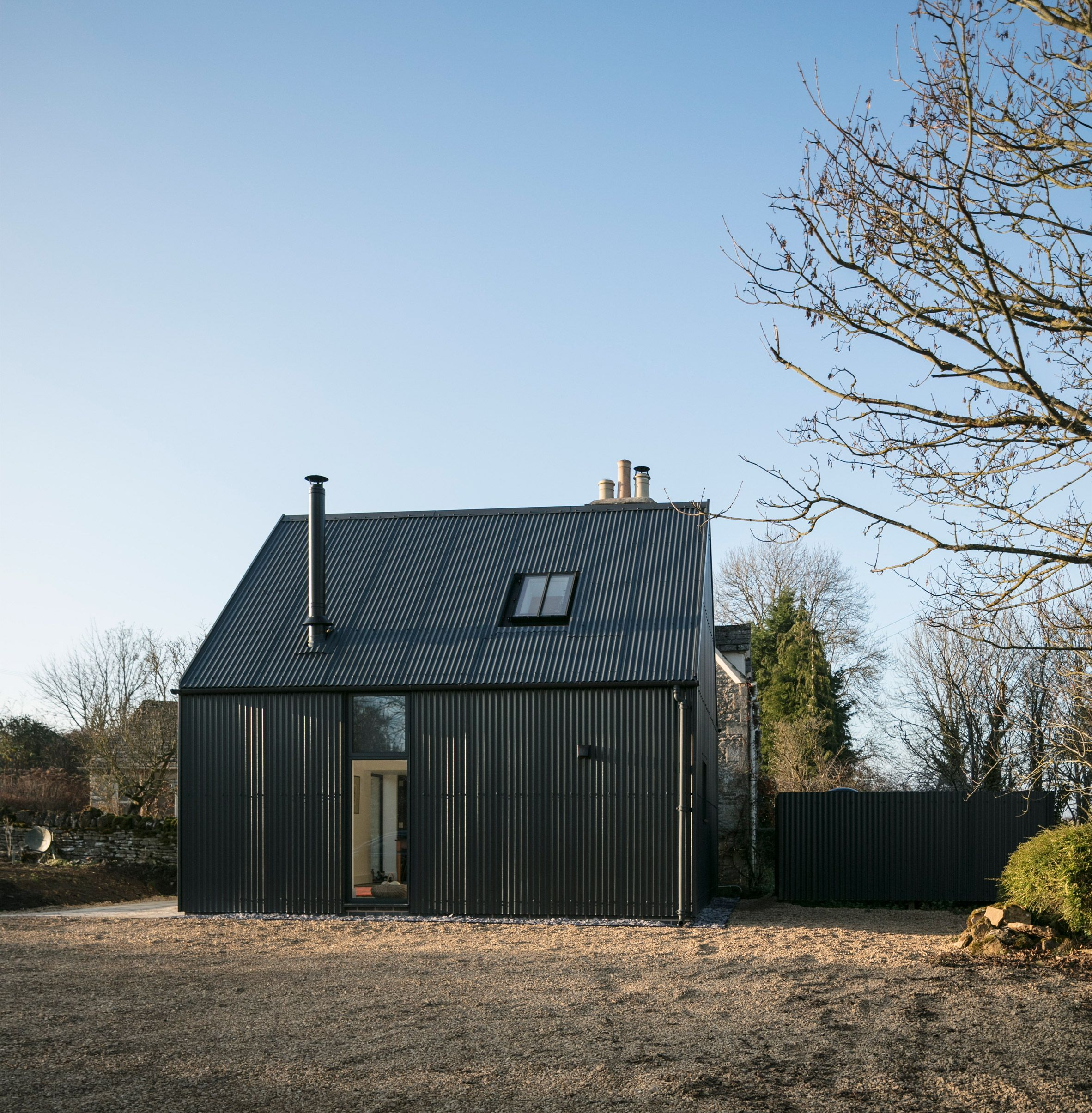 Eastabrook Architects Adds Corrugated Metal Extension To Cotswolds Cottage Cotswolds Cottage Barn Style House Shed Exterior Ideas