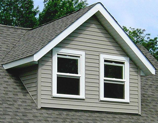 Gable gable dormers have a gabled roof with two sloping for Shed dormer house plans